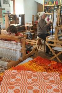 Workshop with corduroy pile rug and overshot shawl