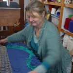 Jill making a knotted pile rug on a weaving course